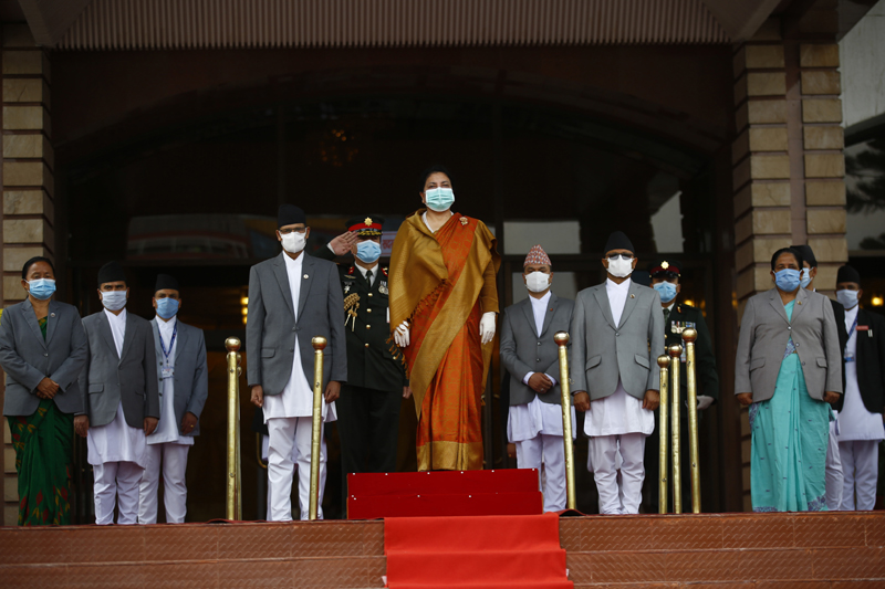President Bidya Devi Bhandari stands for the national anthem before presenting policies and programmes for the new fiscal year at the Federal Parliament, on the 53rd day of government-imposed lockdown, in Kathmandu, on Friday, May 15, 2020. Photo: Skanda Gautam/THT
