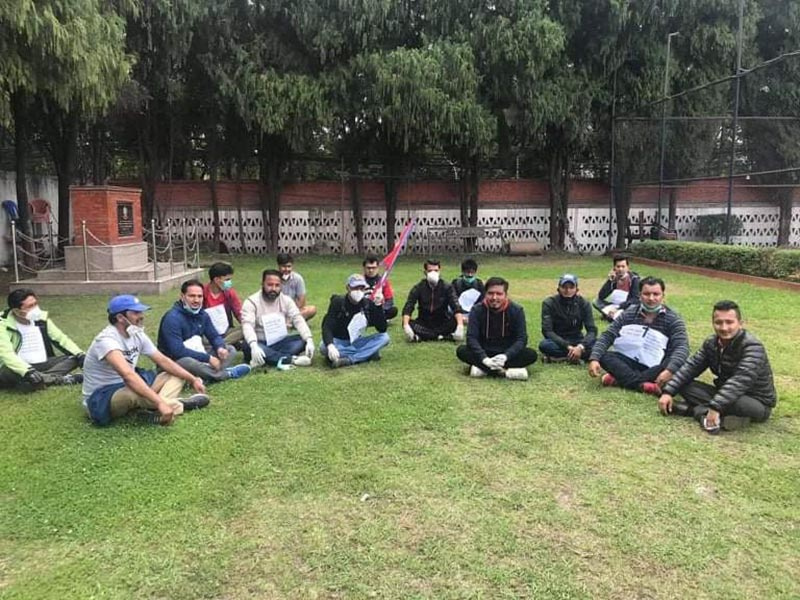 All Nepal National Free Students Union (ANNFSU) members and youth leaders sitting on the lawn  on the premises of Police Club, on Saturday, May 9, 2020. The demonstrators were detained from Indian Embassy area. Photo courtesy: Mahesh Shrestha