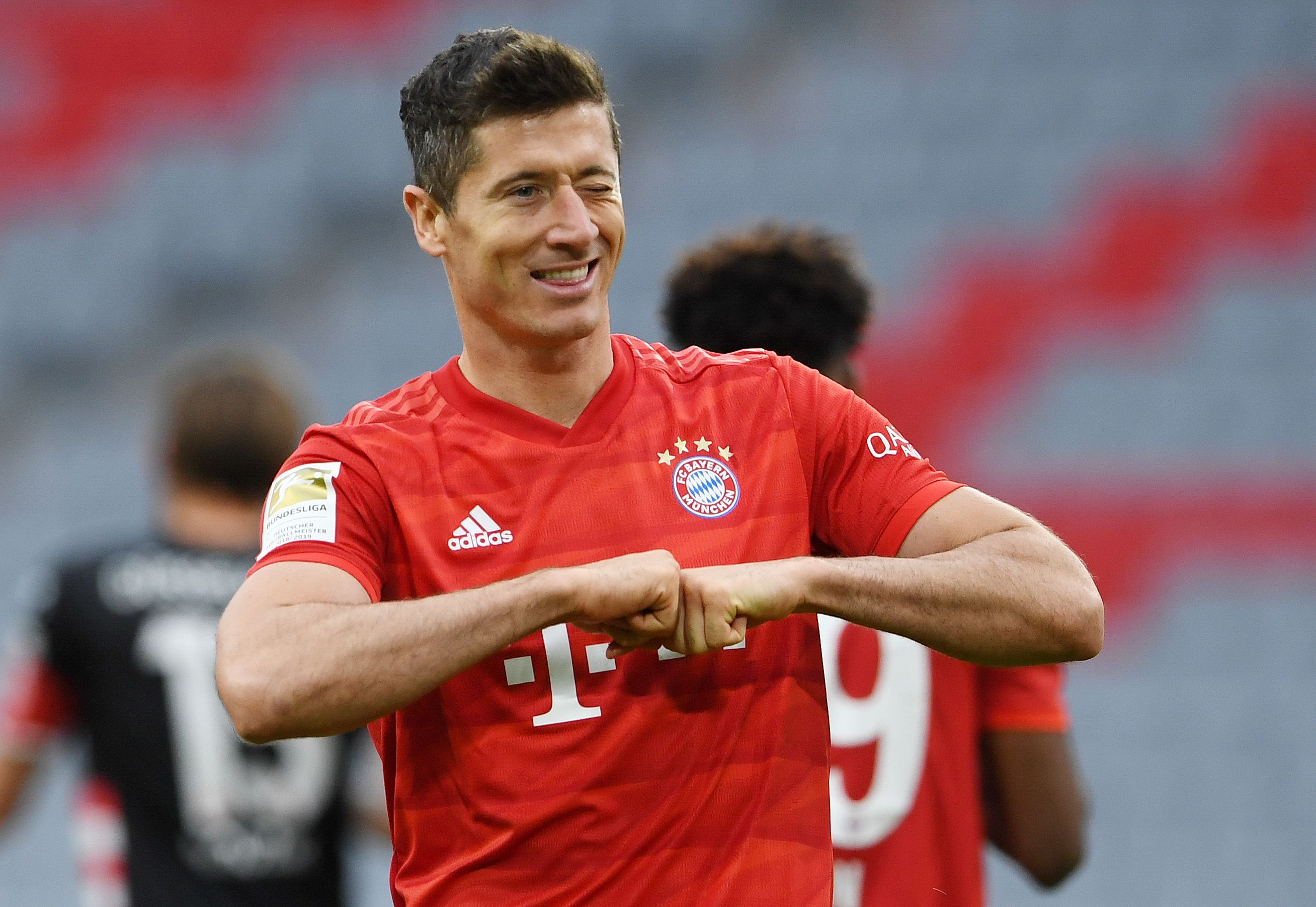 Bayern Munich's Robert Lewandowski celebrates scoring their fourth goal, as play resumes behind closed doors following the outbreak of the coronavirus disease (COVID-19) during the Bundesliga match between Bayern Munich and Fortuna Dusseldorf, at Allianz Arena, Munich, in Germany, on May 30, 2020. Photo: Christof Stache/Pool via Reuters