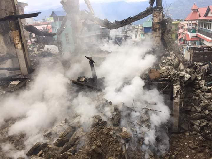 The remains of houses gutted by fire which occurred in Phungling Bazaar, Taplejung district, as seen on Saturday, May 2, 2020. Photo: Laxmi Gautam/THT