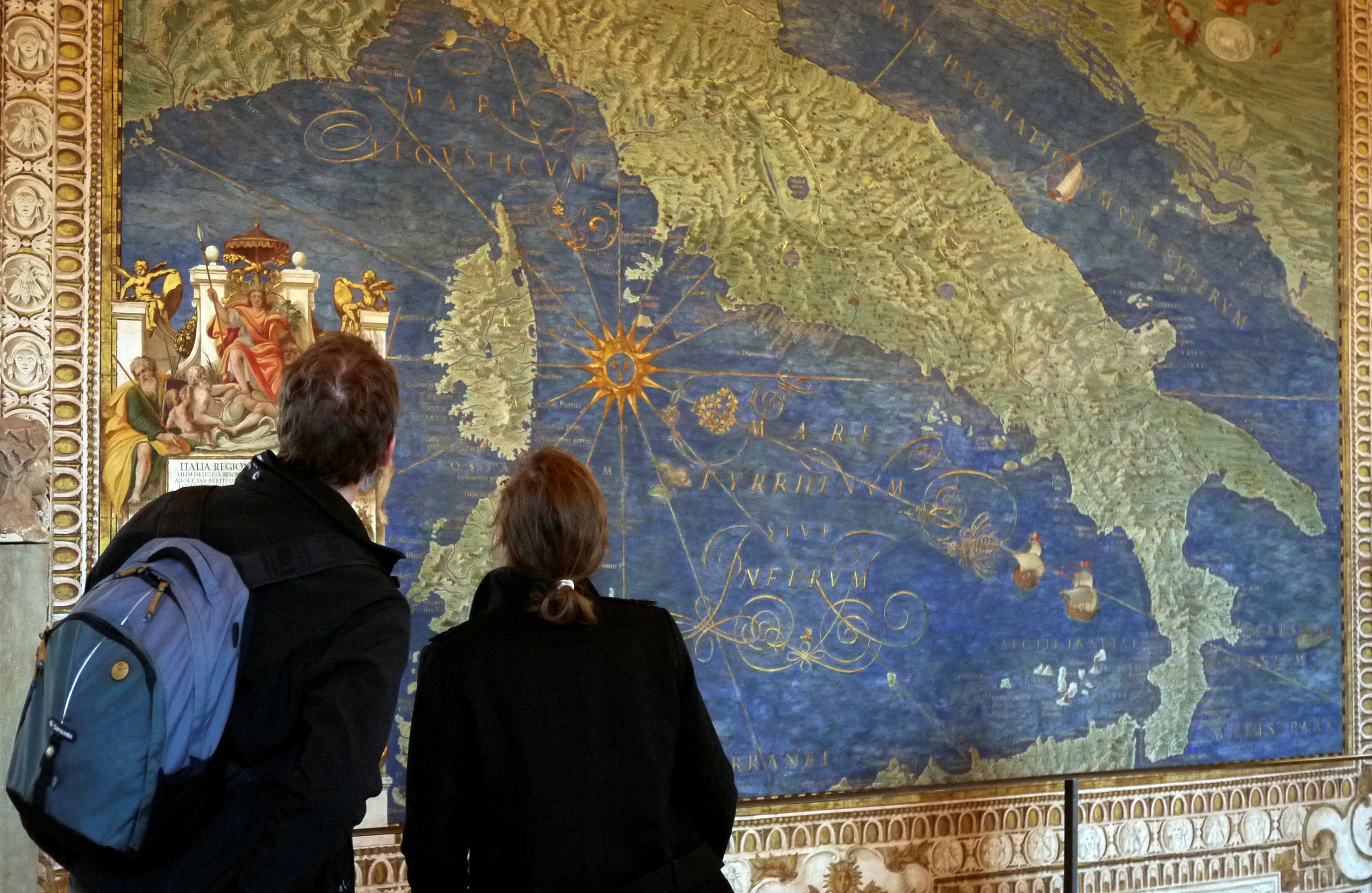FILE PHOTO: A couple view a 16th century frescoe of Italy in the Vatican Museum's Gallery of Maps at the Vatican January 22, 2010. The maps in the gallery were commissioned by Pope Gregory XIII and depict all the regions of Italy and its principal cities at the time. REUTERS/Chris Helgren/File Photo