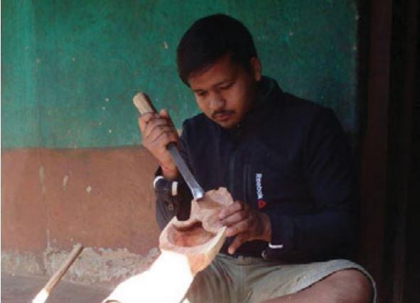 A Gandharba artisan making sarangi in Tanahun. Photo Courtesy: Anil Gandharba