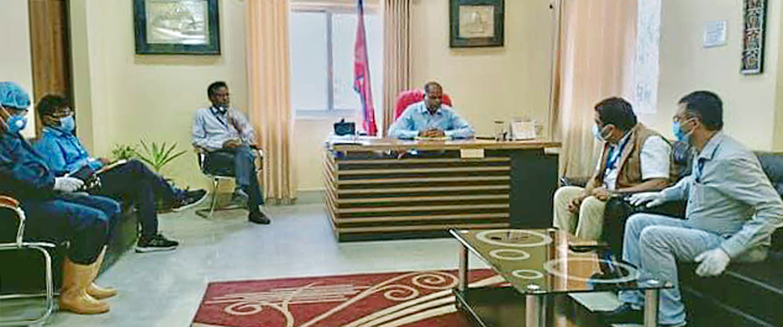 An ongoing meeting to shift the new COVID-19 treatment facility from Naryani Hospital to Gandak Hospital, in Birgunj Metropolitan City Office, on Saturday, May 9, 2020. Photo: Ram Sarraf/THT
