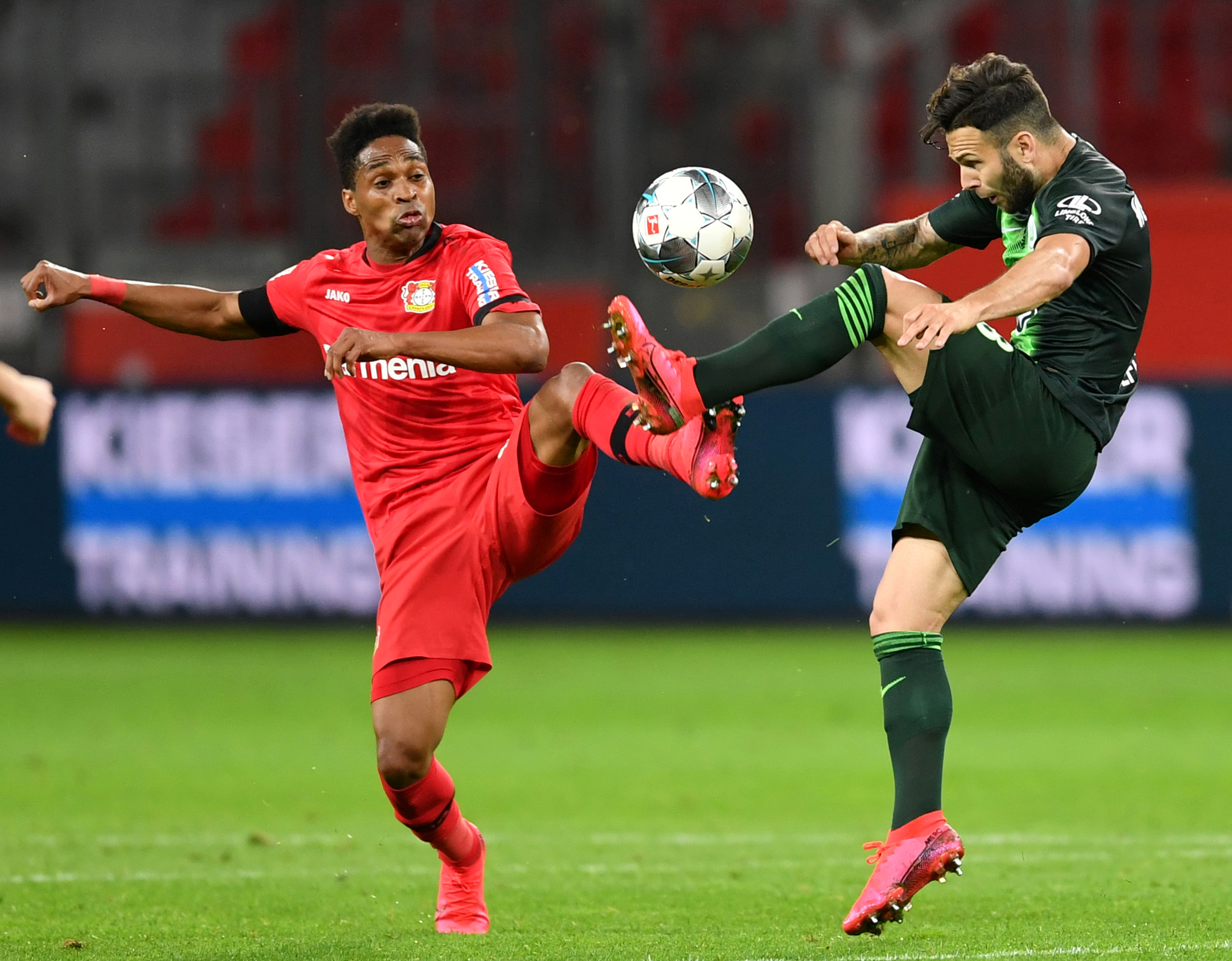 Bayer Leverkusen's Wendell in action with VfL Wolfsburg's Renato Steffen, as play resumes behind closed doors following the outbreak of the coronavirus disease (COVID-19) during the  Bundesliga match between Bayer Leverkusen and VfL Wolfsburg, at BayArena, Leverkusen, Germany, on May 26, 2020. Photo: Marius Becker/Pool via Reuters