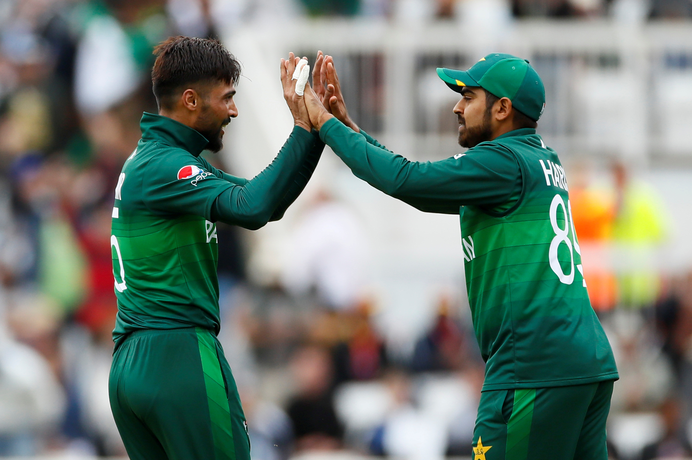 FILE PHOTO: Cricket - ICC Cricket World Cup - West Indies v Pakistan - Trent Bridge, Nottingham, Britain - May 31, 2019   Pakistan's Mohammad Amir celebrates with Haris Sohail after taking the wicket of West Indies' Chris Gayle    Action Images via Reuters/Jason Cairnduff/File Photo