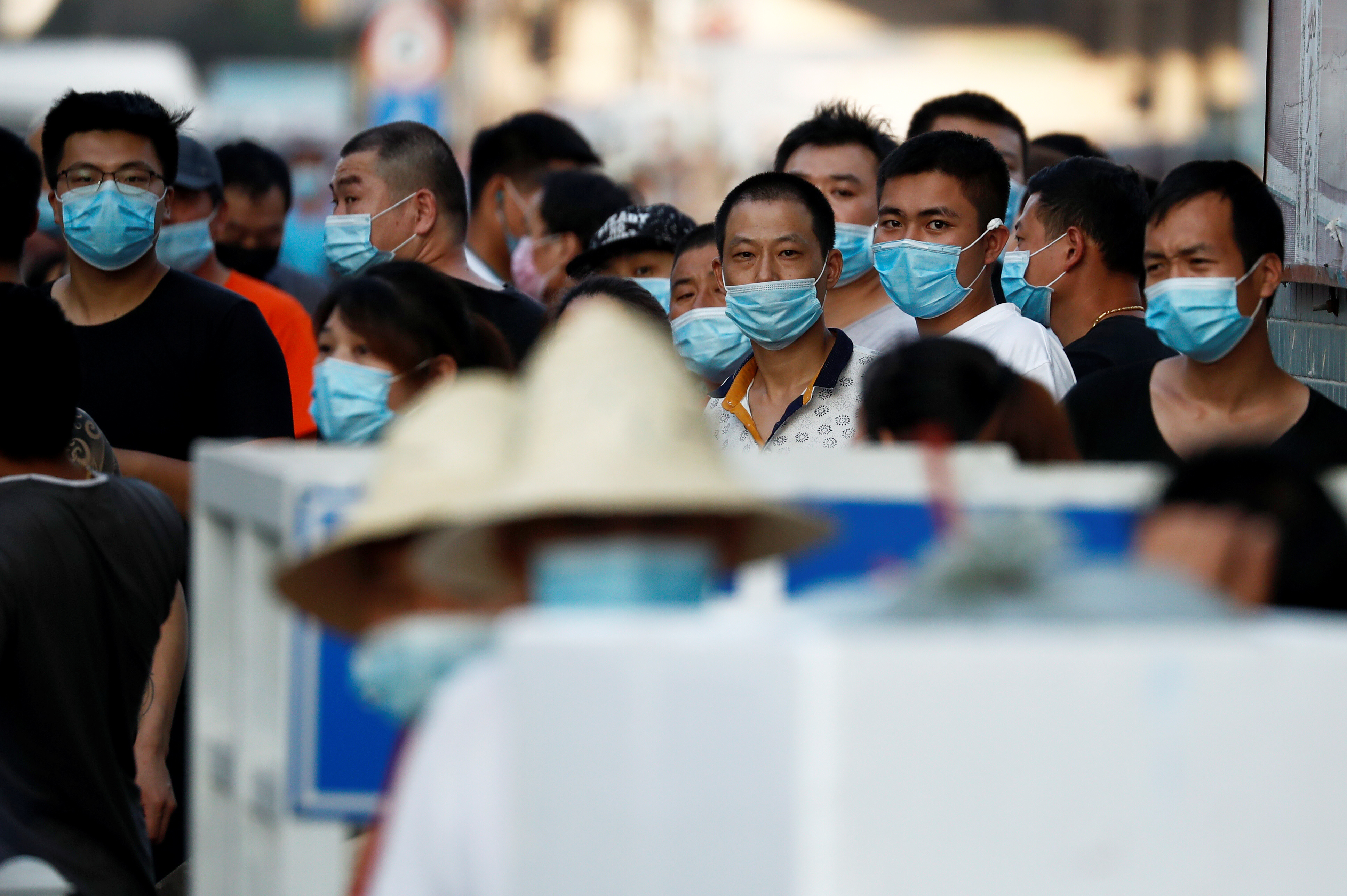 People are wearing face masks inside the Jingshen seafood market which has been closed for business after new coronavirus infections were detected, in Beijing, China, June 12, 2020. Photo: Reuters