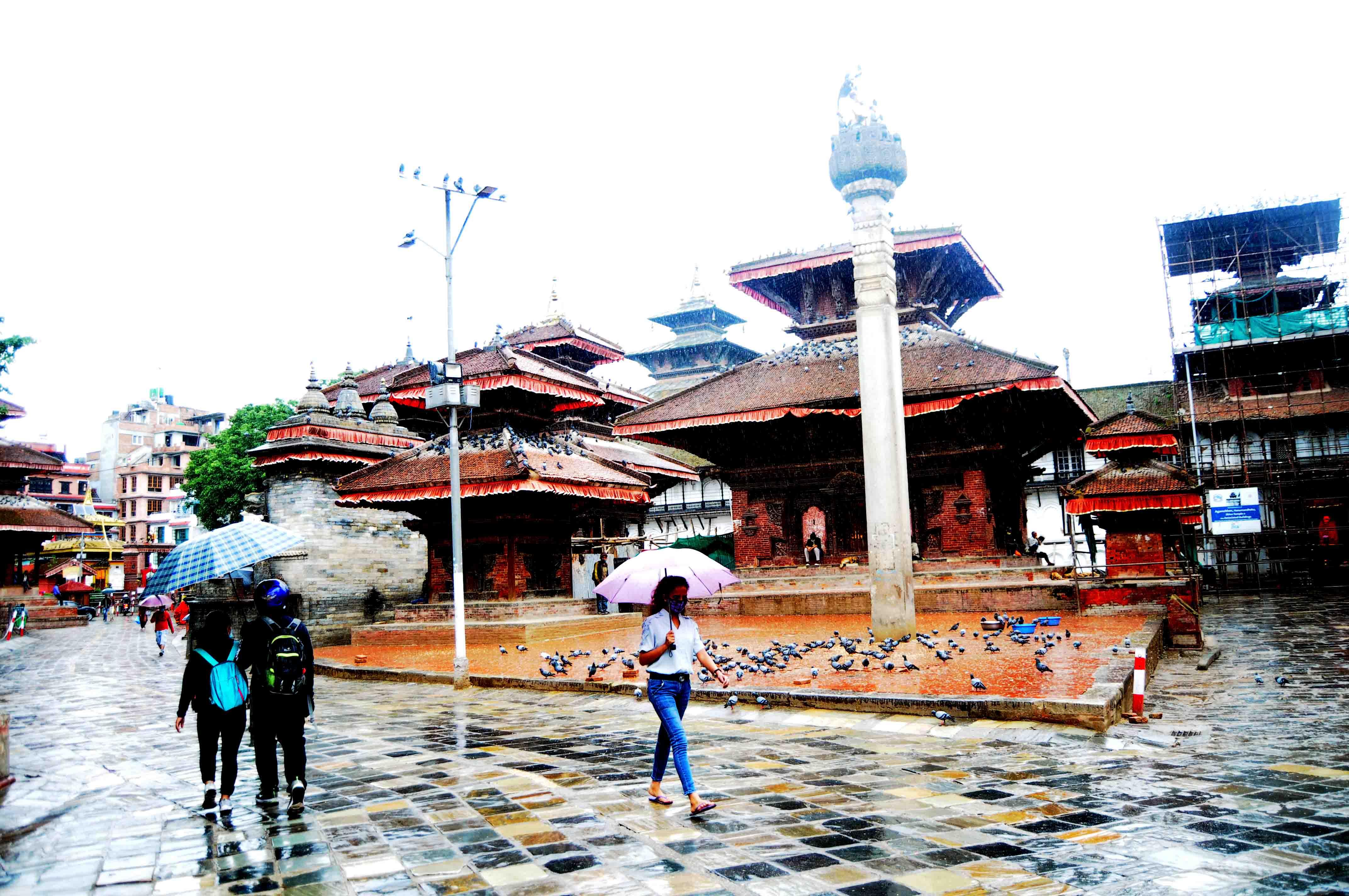 People go out and about on a rainy day, under their umberellas, at Hanumandhoka in kathmandu on Sunday. Photo: Balkrishna Thapa Chhetri/THT