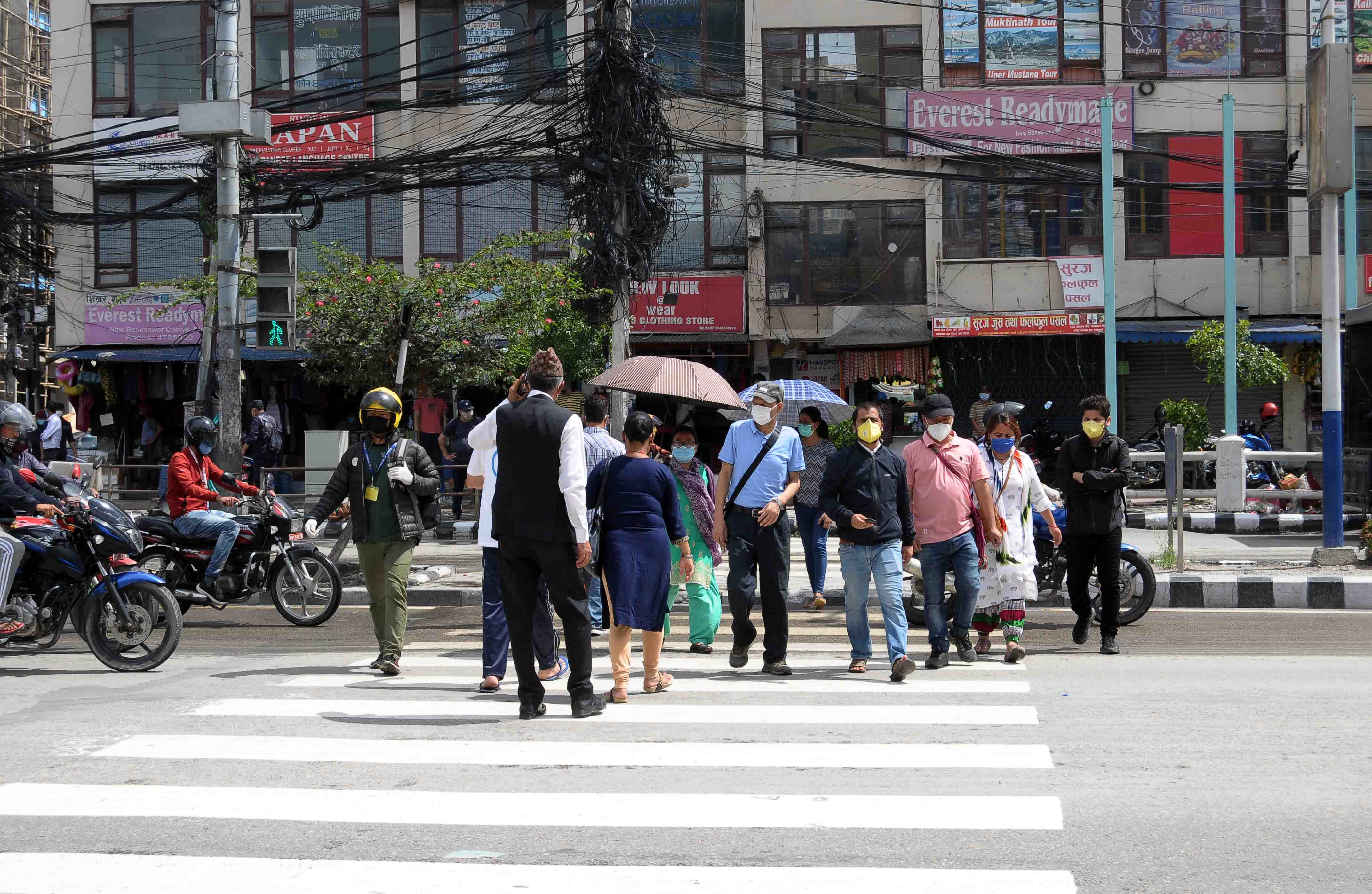 Traffic lights have been started after more vehicles are seen on the road after government decided to lighten lockdown in New Baneshwor Chowk, Kathmandu, on Monday. PHOTO: BALKRISHNA THAPA CHHETRI