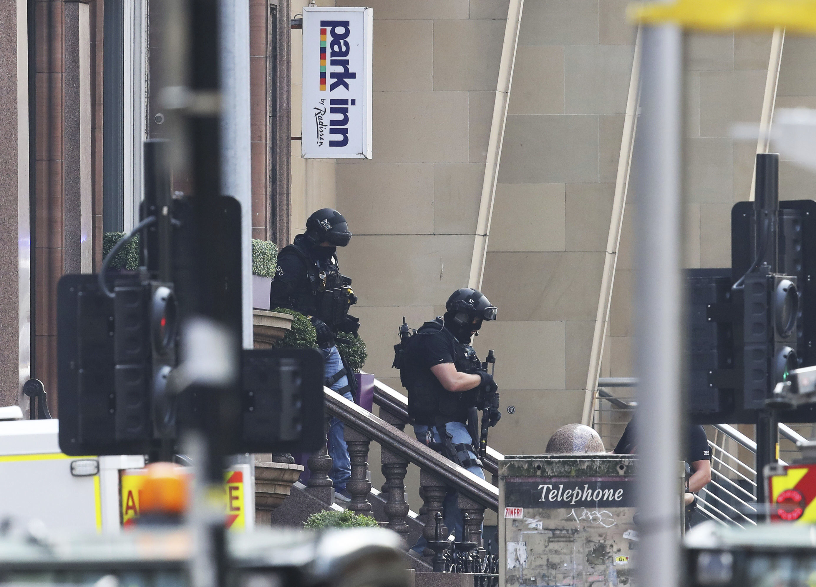 Armed police at the scene of an incident in Glasgow, Scotland, Friday June 26, 2020. Scottish police say the individual shot by armed police during an incident in Glasgow has died and that six other people including a police officer are in hospital being treated for their injuries. Photo: AP