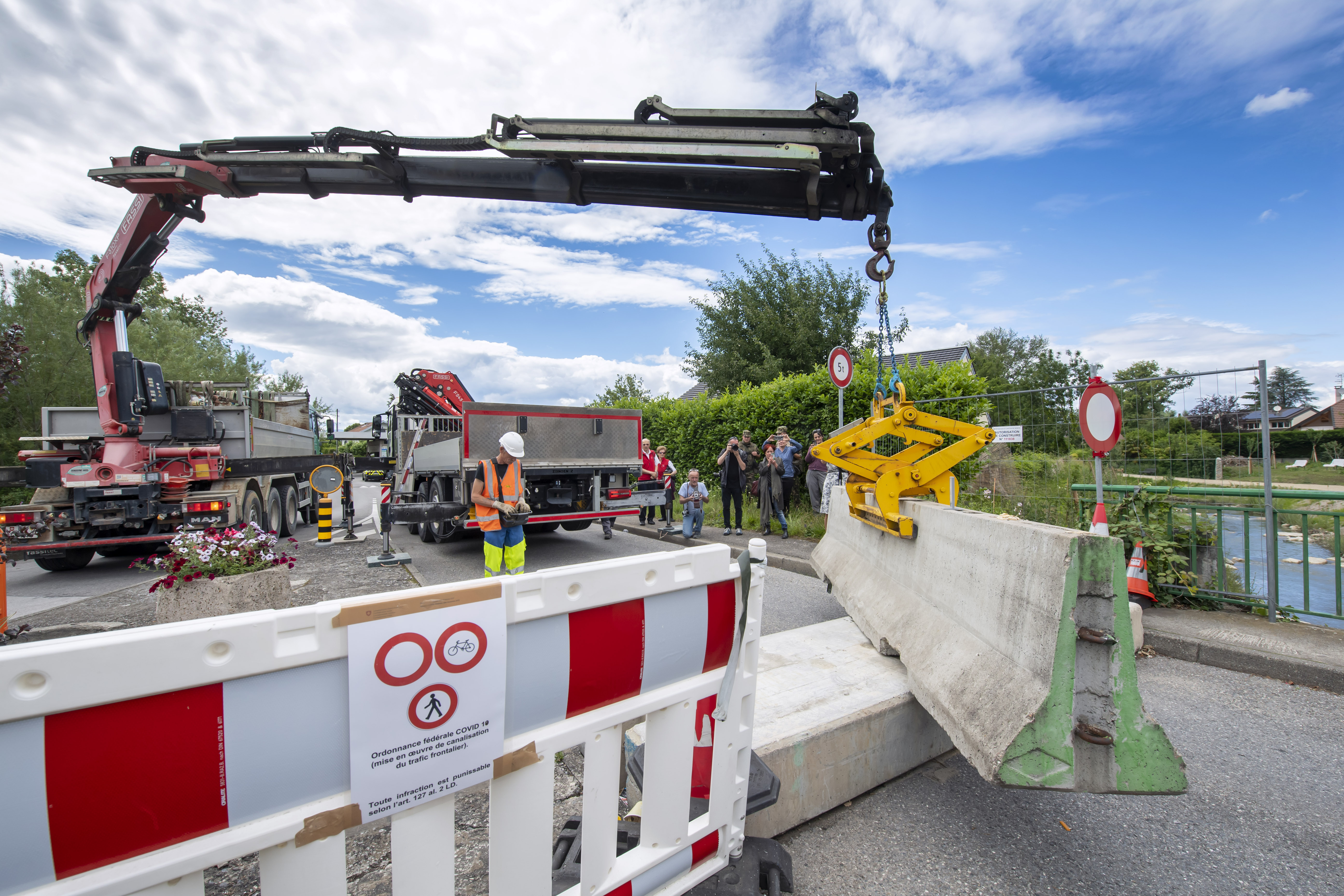FILE - In this  Sunday, June 14, 2020 file photo, a crane removes the concrete blocks that closed customs access, in Thonex near Geneva, Switzerland. The European Union is set to make public Tuesday June 30, 2020, a list of countries whose citizens will be allowed to enter 31 European countries, but most Americans are likely to be refused entry for at least another two weeks due to soaring coronavirus infections in the U.S. Photo: AP