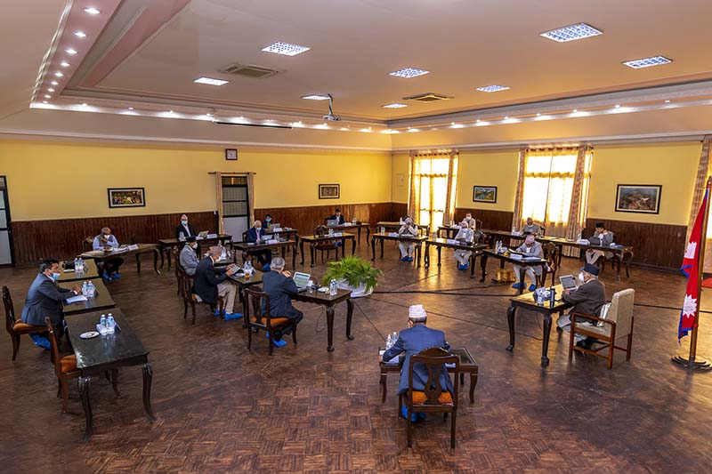 Prime Minister KP Sharma oli and other ministers take part in cabinet meeting at PM's official residence in Baluwatar, Kathmandu, on Monday, June 29, 2020. Photo: RSS