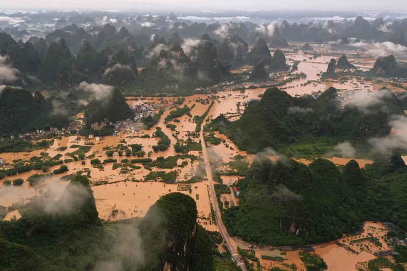 Floodwaters surround a village in Yangshuo in Guilin in southern China's Guangxi Zhuang Autonomous Region, June 7, 2020. Photo: Lu Boan/Xinhua via AP, File
