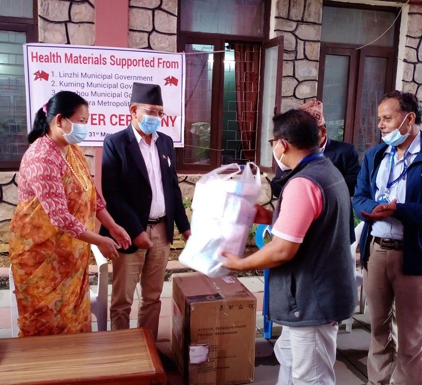 Mayor Man Bahadur GC handing over medical items to FNJ Kaski Chair Dipendra Shrestha in Pokhara, on Sunday. Photo: THT