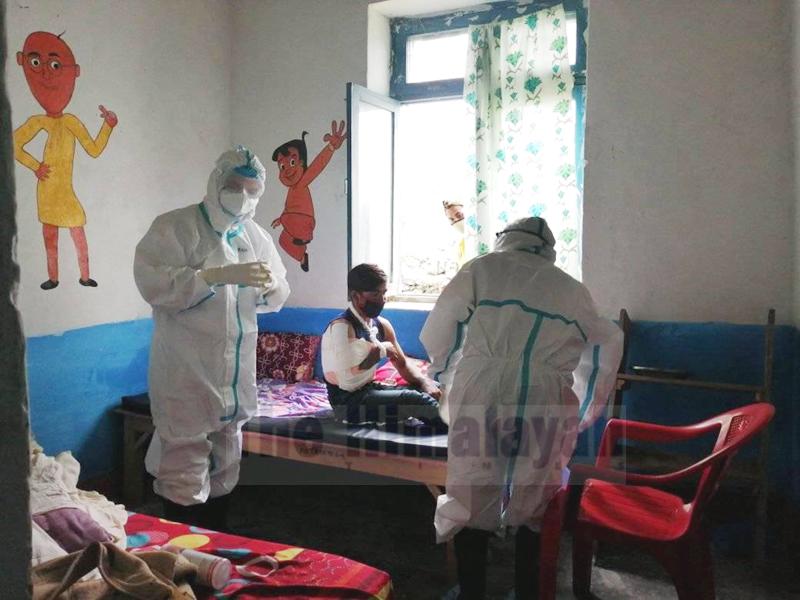 Dr Govinda KC providing treatment to a patient at Kolti Primary Health Centre, in Kolti, Bajura, on Wednesday, June 24, 2020. Photo: Prakash Singh/THT