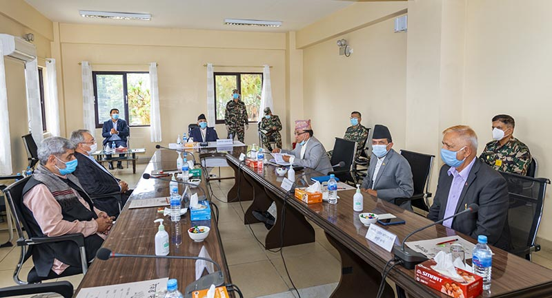 A meeting of the High-Level Coordination Committee for the Prevention and Control of COVID-19, chaired by Prime Minister KP Sharma Oli, at COVID-19 Crisis Managment Centre, in Chhauni, Kathmandu, on Wednesday, May 20, 2020. Photo Courtesy: Rajan Kafle/Prime Minister's Secretariat