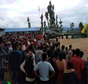 Locals gather around as army chopper prepares to airlift the injured person to Surkhet Hospital from Jajarkot district, on Monday, June 29, 2020. Photo: Dinesh Kumar Shrestha/THT