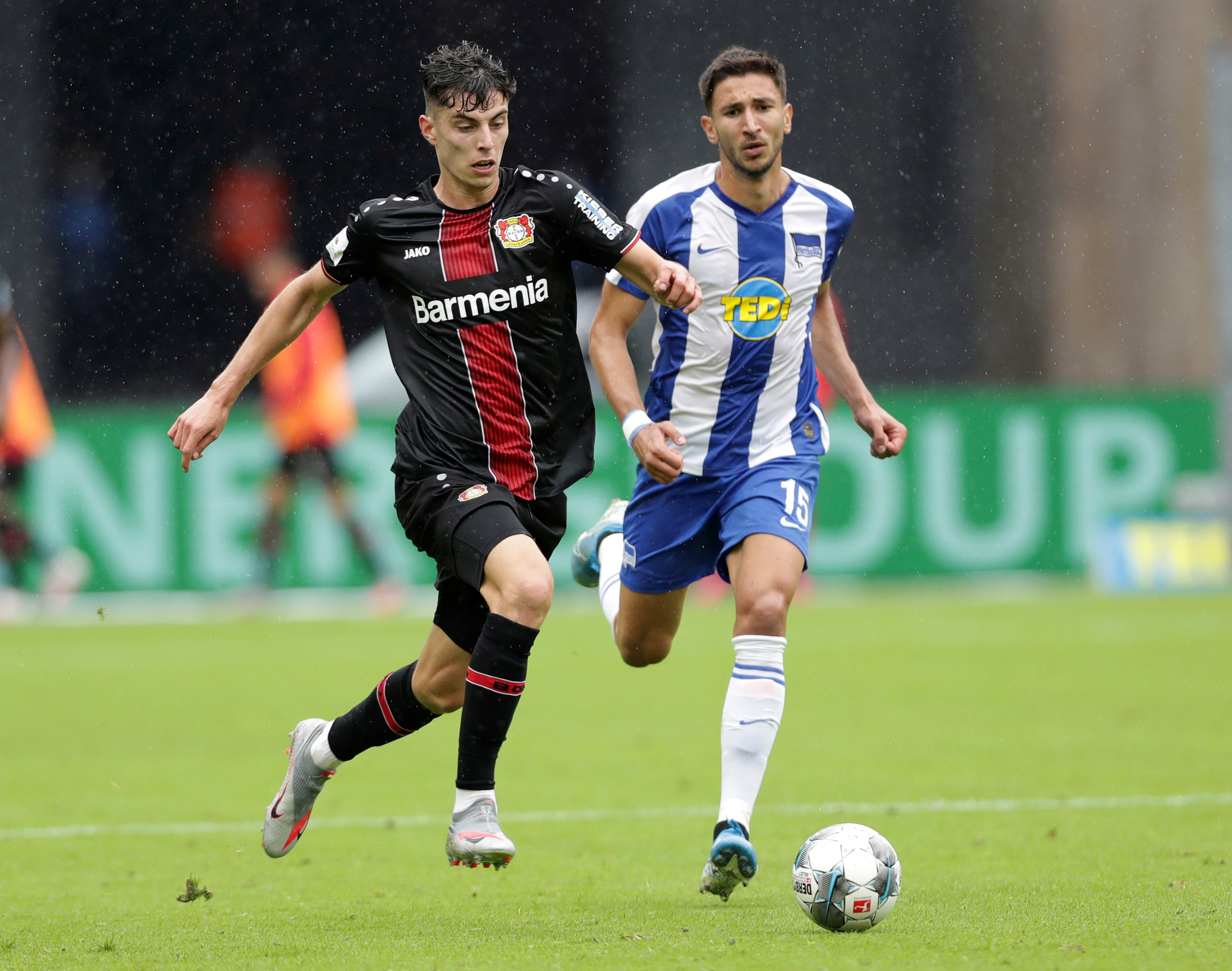 Berlin's Marko Grujic (blue jersey) in action with Leverkusen's Kai Havertz, following the resumption of play behind closed doors after the outbreak of the coronavirus disease (COVID-19). Photo: Reuters