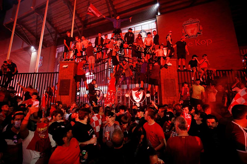 Liverpool fans celebrate winning the Premier League. Photo: Reuters