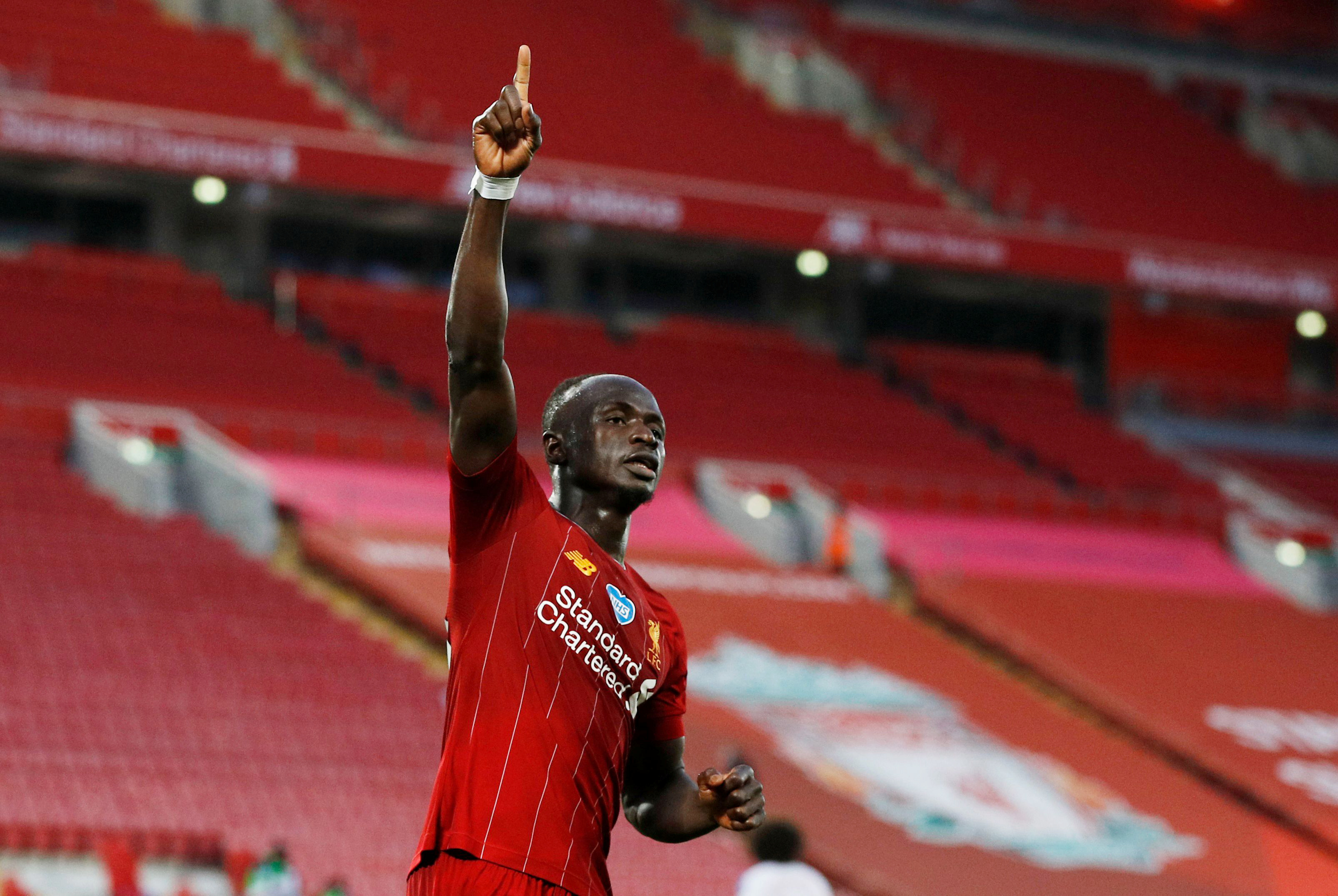Liverpool's Sadio Mane celebrates scoring their fourth goal, as play resumes behind closed doors following the outbreak of the coronavirus disease (COVID-19) during the Premier League match between Liverpool and Crystal Palace, at Anfield, in Liverpool, Britain, on  June 24, 2020. Photo: Reuters