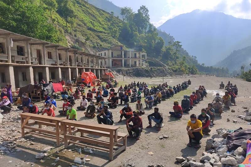 People quarantined in Gaumul Rural Municipality of Bajura district participating in a yoga class, on Friday, June 12, 2020. Photo: Prakash Singh/THT