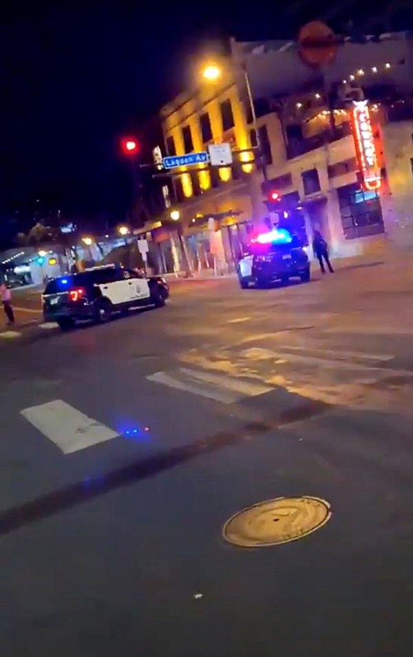 Police vehicles block the road after a shooting in Minneapolis, Minnesota, U.S. June 21, 2020, in this picture obtained from social media video. Photo: TWITTER @MRMINNESOTA24 /via Reuters