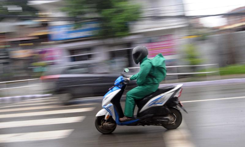 Motorbike riders appear in raincoats on the road as monsoon brings heavy rain, in Jawalakhel, Lalitpur, on Thursday, June 25, 2020. Photo: Balkrishna Thapa Chhetri/THT