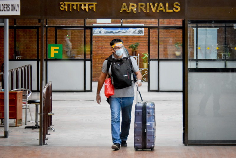 Stranded Nepali nationals arrive on Friday at the Tribhuvan International Airport from Myanmar on a chartered flight arranged by the government to rescue targeted set of 40,000 Nepalis stranded abroad in the first phase. Photo: Naresh Shrestha/THT