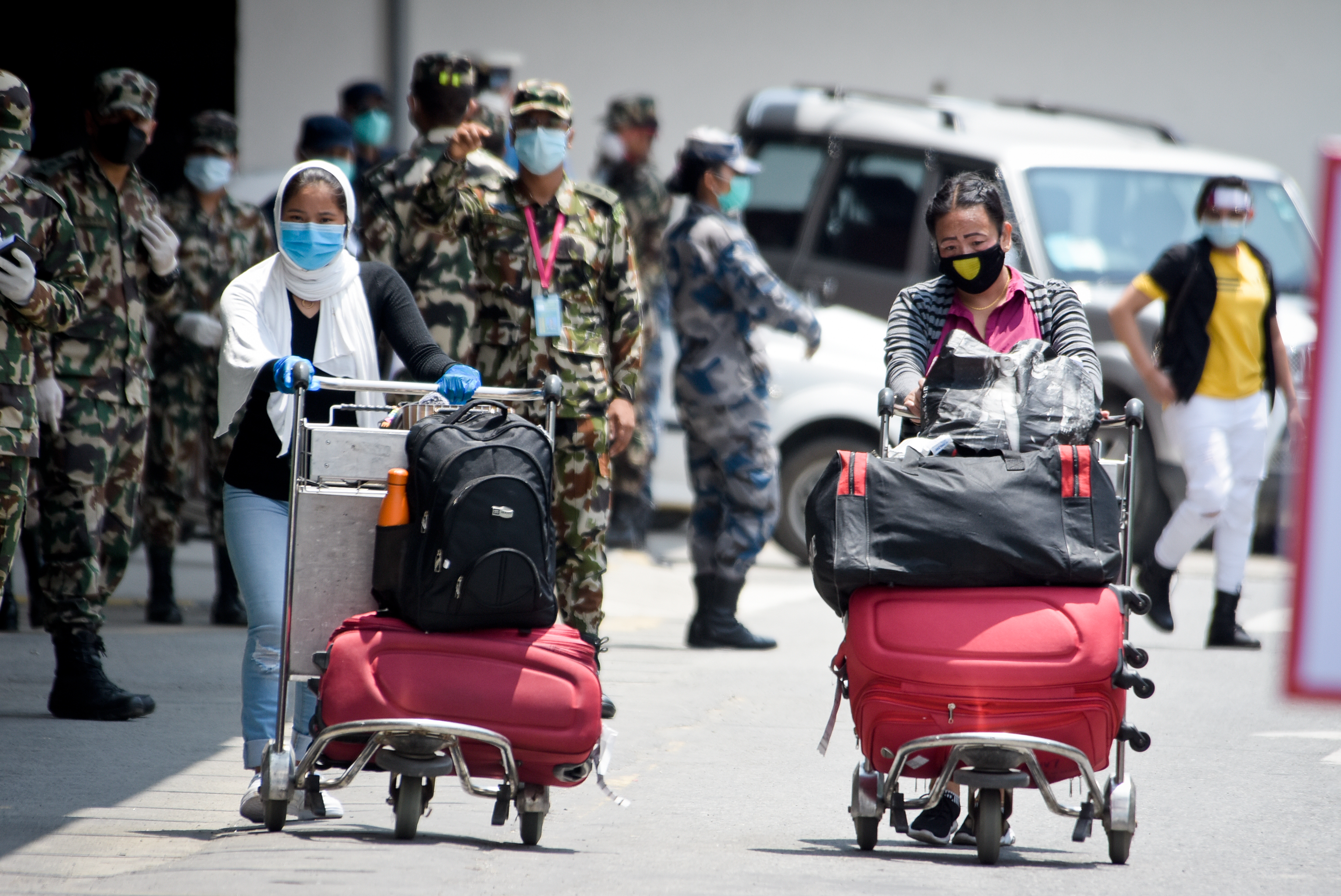 Nepali migrant workers previously stranded in Kuwait due to restrictions imposed on travelling, as a preventive measure against the spread of coronavirus infection, are seen arriving at the Tribhuvan International Airport, in Kathmandu, on June 11, 2020. Photo: Naresh Shrestha/THT