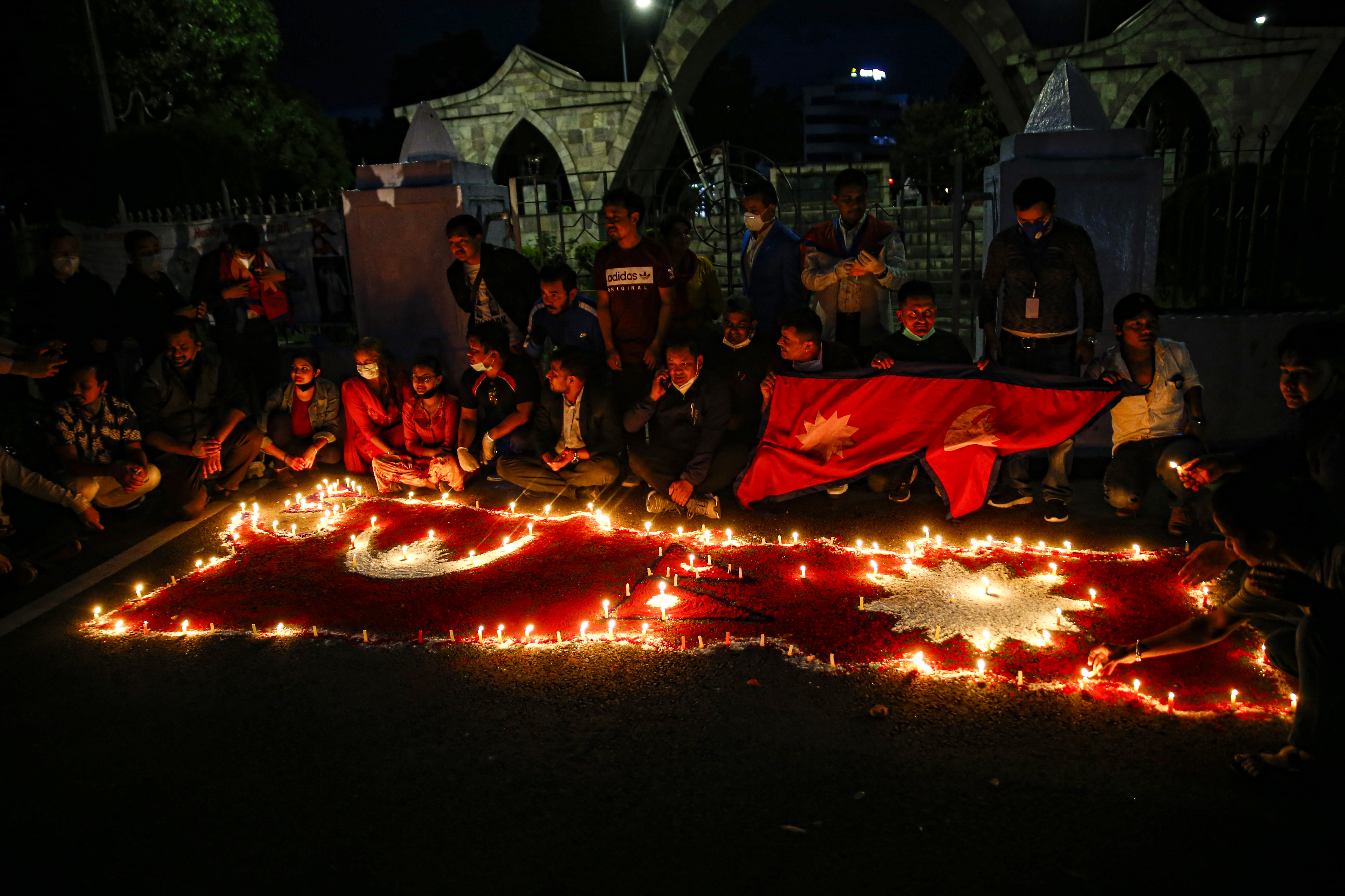 Nepali citizens light candles around the new political map of Nepal after parliament passed the constitution amendment bill to update the national coat of arms by incorporating Limpiyadhura, Lipulekh and Kalapani in Nepalu2019s map, in Kathmandu, on Saturday, June 13, 2020. Photo: Skanda Gautam/THT