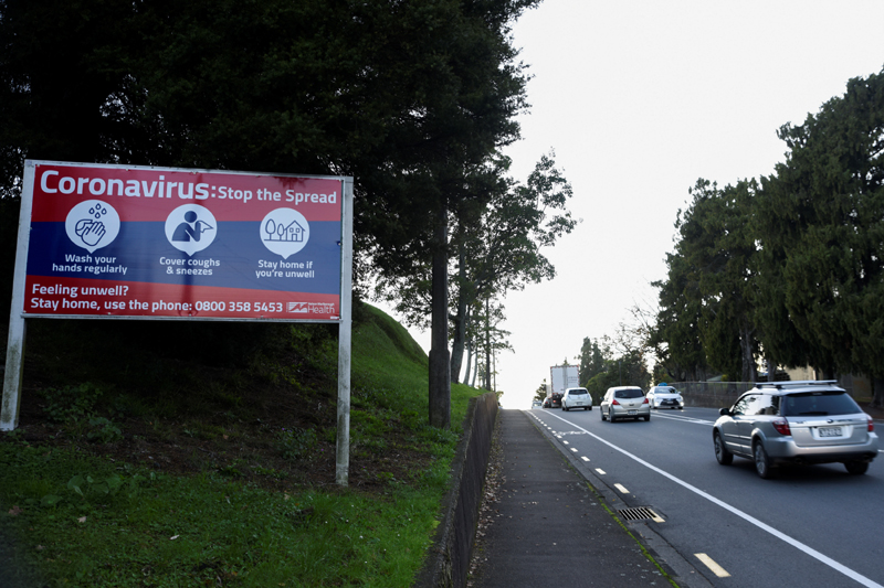 Morning traffic passes a warning sign on the first day of all New Zealand domestic regulations being lifted for the coronavirus disease (COVID-19) in Nelson, New Zealand, June 9, 2020.  Photo: Reuters