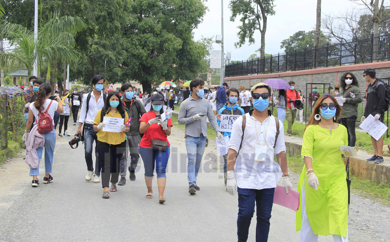 Youths protest demanding transparency in COVID-19 related expenses, expansion of PCR testing, in front of the District Administration Office, Pokhara, on Thursday, June 11, 2020. Photo: Bharat Koirala/THT