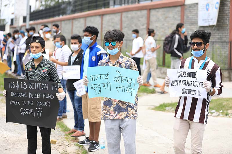 Protesters display placards bearing anti-government slogans in front of Kaski District Administration Office, Pokhara, on Thursday, June 11, 2020. Photo: Rishiram Baral/THT