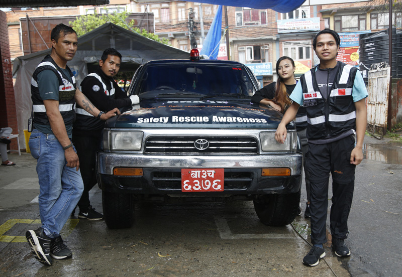 Members of the RNA-16 volunteer group, from left, Arun Saiju, Rajesh Gaiju, Punam Karmacharya and Nhuja Kaiju stand for a photograph during an interview with the Associated Press at a hospital in Bhaktapur, Nepal, Tuesday, May 26, 2020. Photo: AP