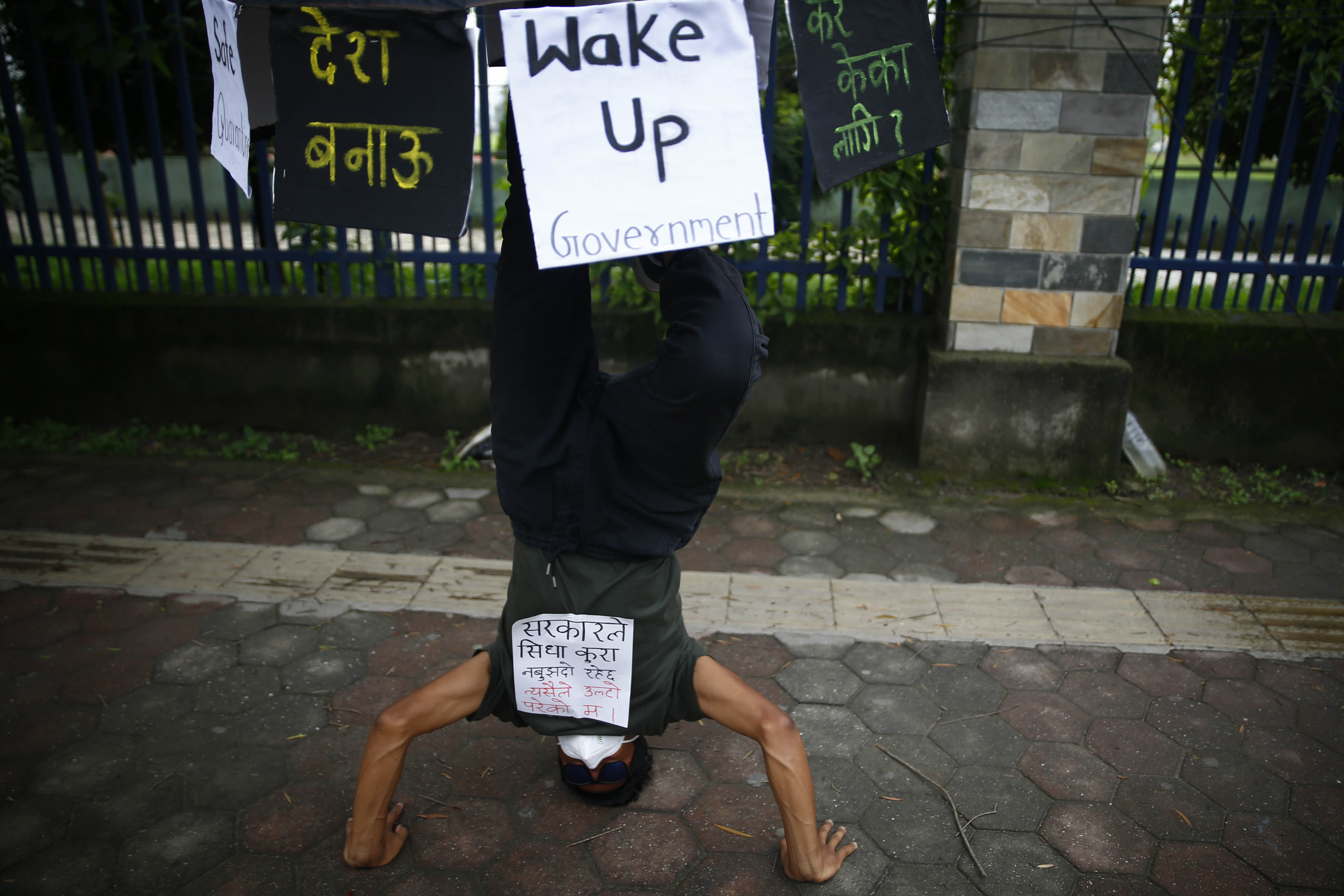 A youth displays a move during a symbolic protest against the incompetence displayed by the government in dealing with coronavirus crisis, in Kathmandu, on Saturday, June 20, 2020. Photo: Skanda Gautam/THT