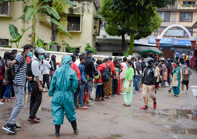 People queue up for Covid-19 test at Sukraraj Tropical and Infectious Diseases Hospital in Teku on Friday. The Health Ministry to day urged all to follow safety protocol and maintain safe distance in public places. Photo: Naresh Shrestha/THT