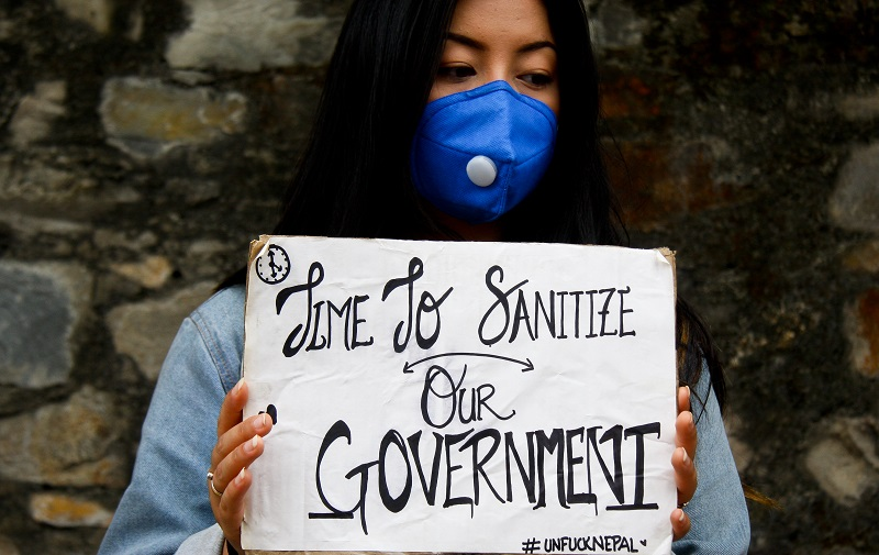 A demonstrator holds a placard in protest of the government's ineffective handling of the coronavirus pandemic, in Kathmandu, on Wednesday, June 10, 2020. Photo: Naresh Shrestha/THT