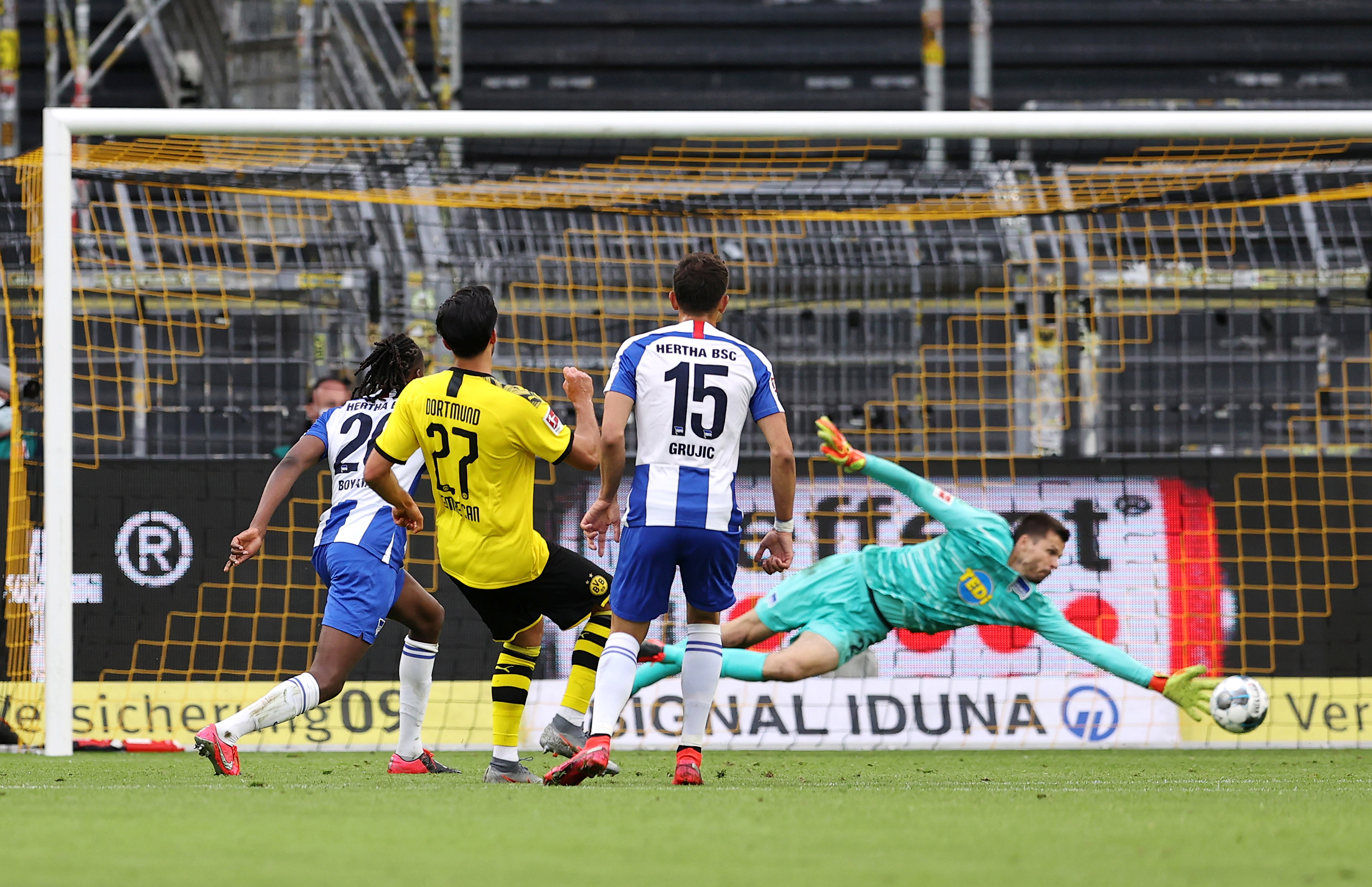 Borussia Dortmund's Emre Can scores their first goal, as play resumes behind closed doors following the outbreak of the coronavirus disease (COVID-19) during the  Bundesliga match between Borussia Dortmund and Hertha BSC, at Signal Iduna Park, in Dortmund, Germany, on June 6, 2020. Photo: Lars Baron/Pool via Reuters