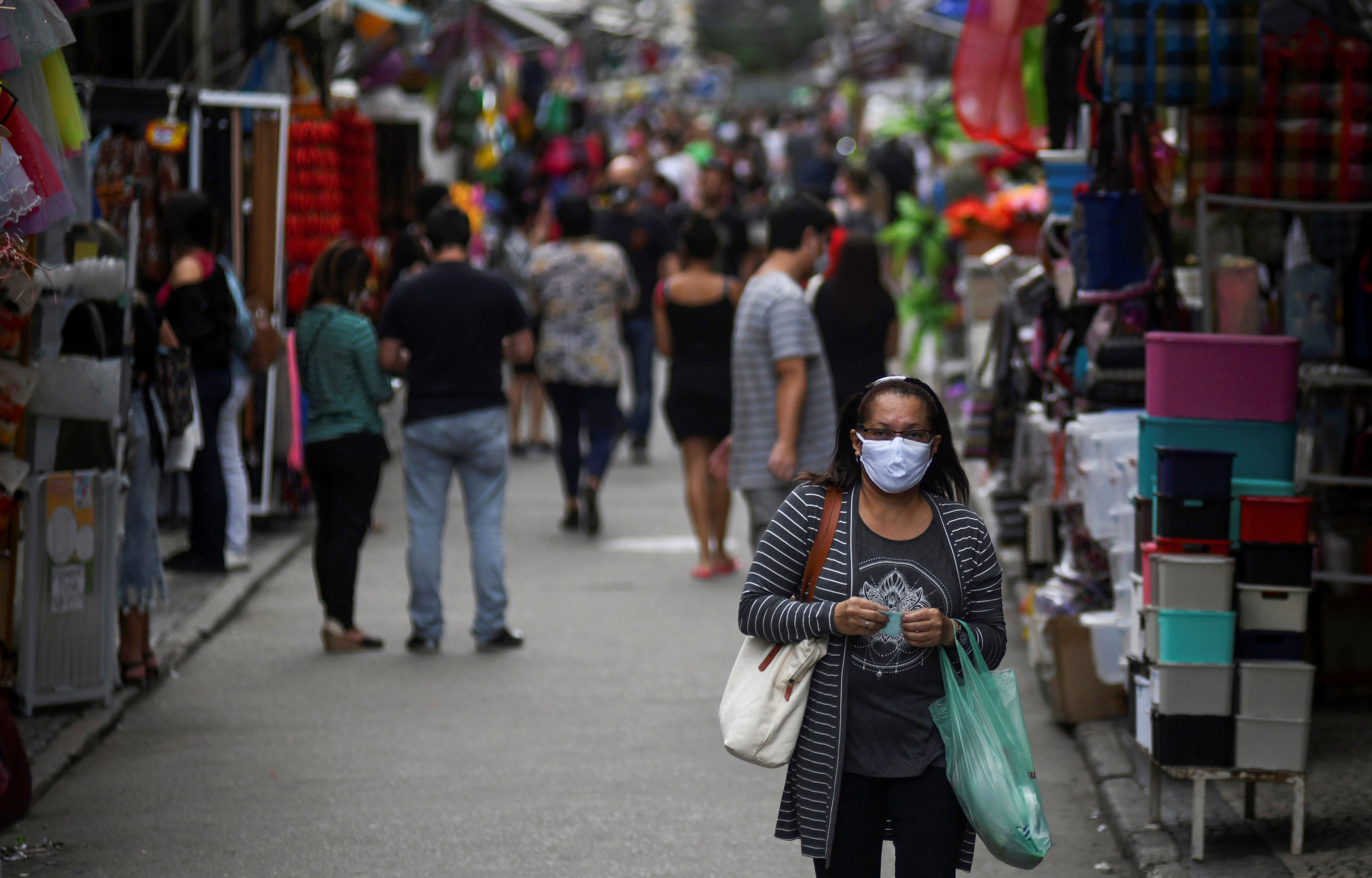 People walk at a popular shopping street, as the city eases restrictions and allows commerce to open, amid the coronavirus disease (COVID-19) outbreak in Rio de Janeiro, Brazil June 29, 2020.  Photo: Reuters