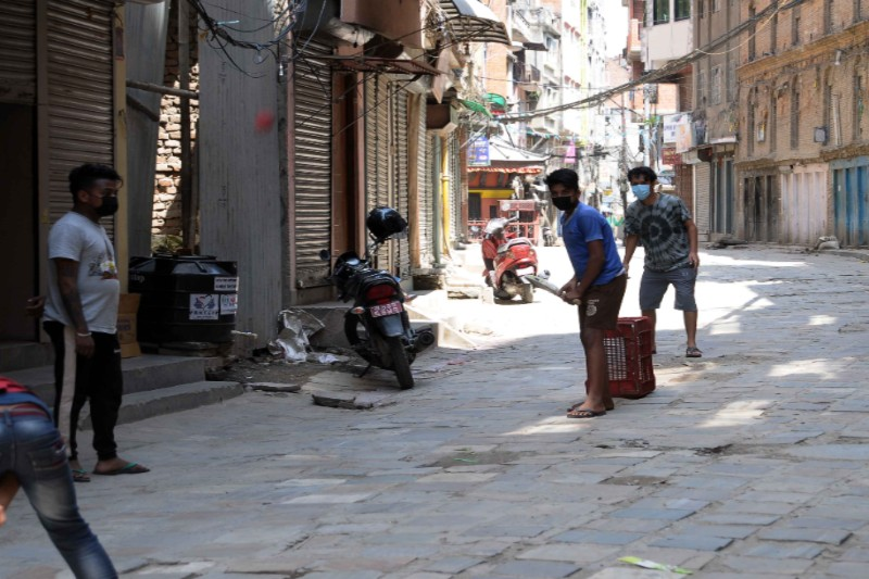 Local youths playing cricket during lockdown, with their masks on, for safety, in Chhetrapati, Kathmandu, on Tuesday, June 2, 2020. Photo: Balkrishna Thapa Chhetri/THT