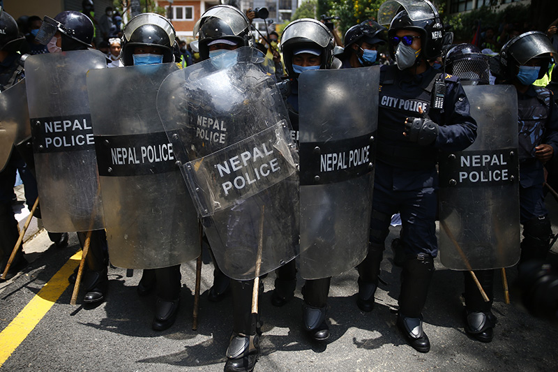 Police charge to disperse hundreds of protesters during a protest against governmentu2019s ineffective handling of the coronavirus pandemic near the Prime Minister's official residence in Kathmandu, Nepal on Thursday, June 11, 2020.