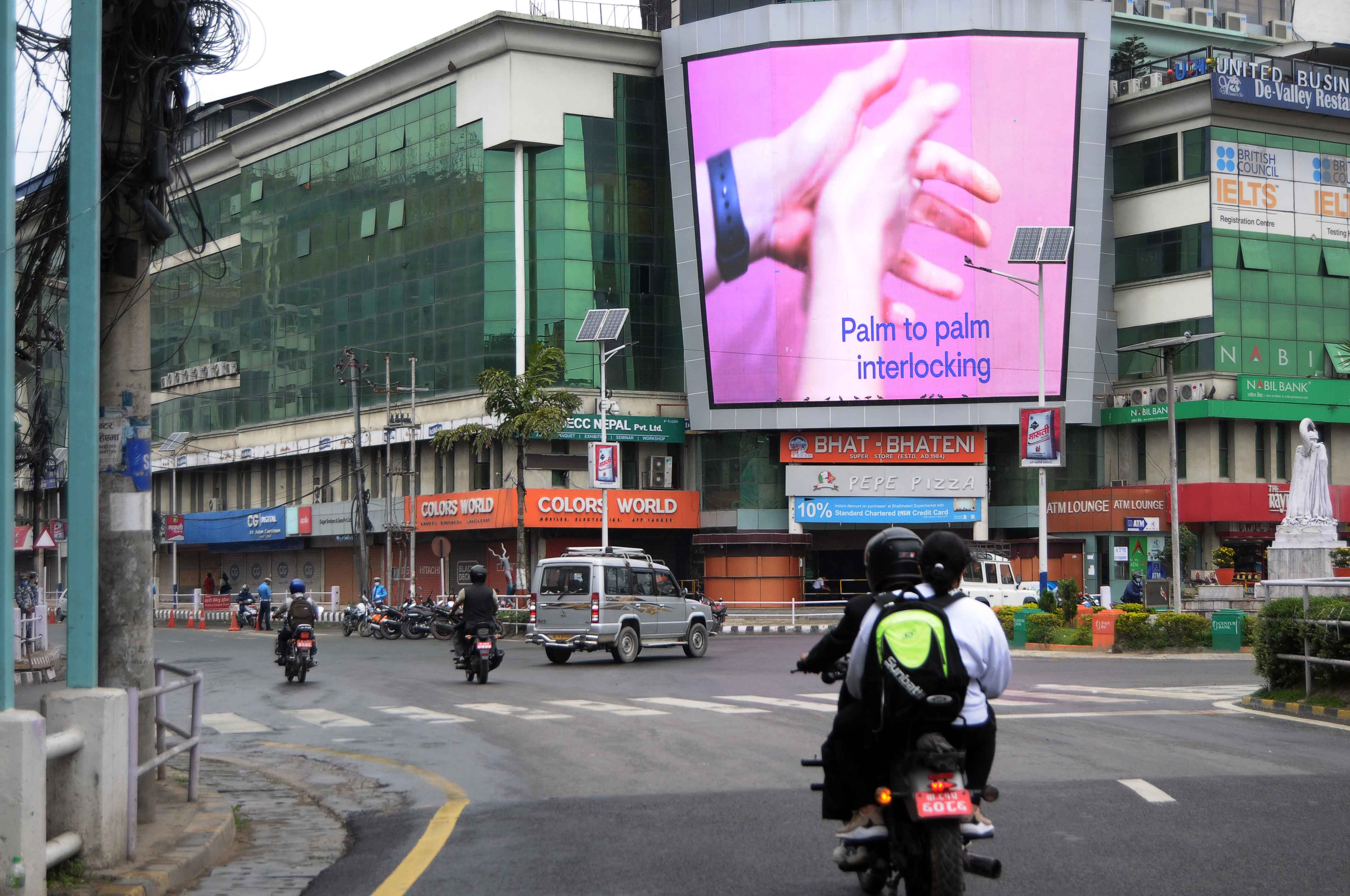 File - A screen displays the method of washing and sanitising hands for awareness on hand hygiene as a vital measure against COVID-19 transmission, in Tripureshwor, Kathmandu, on Tuesday, June 9, 2020. Photo: Balkrishna Thapa Chhetri/THT