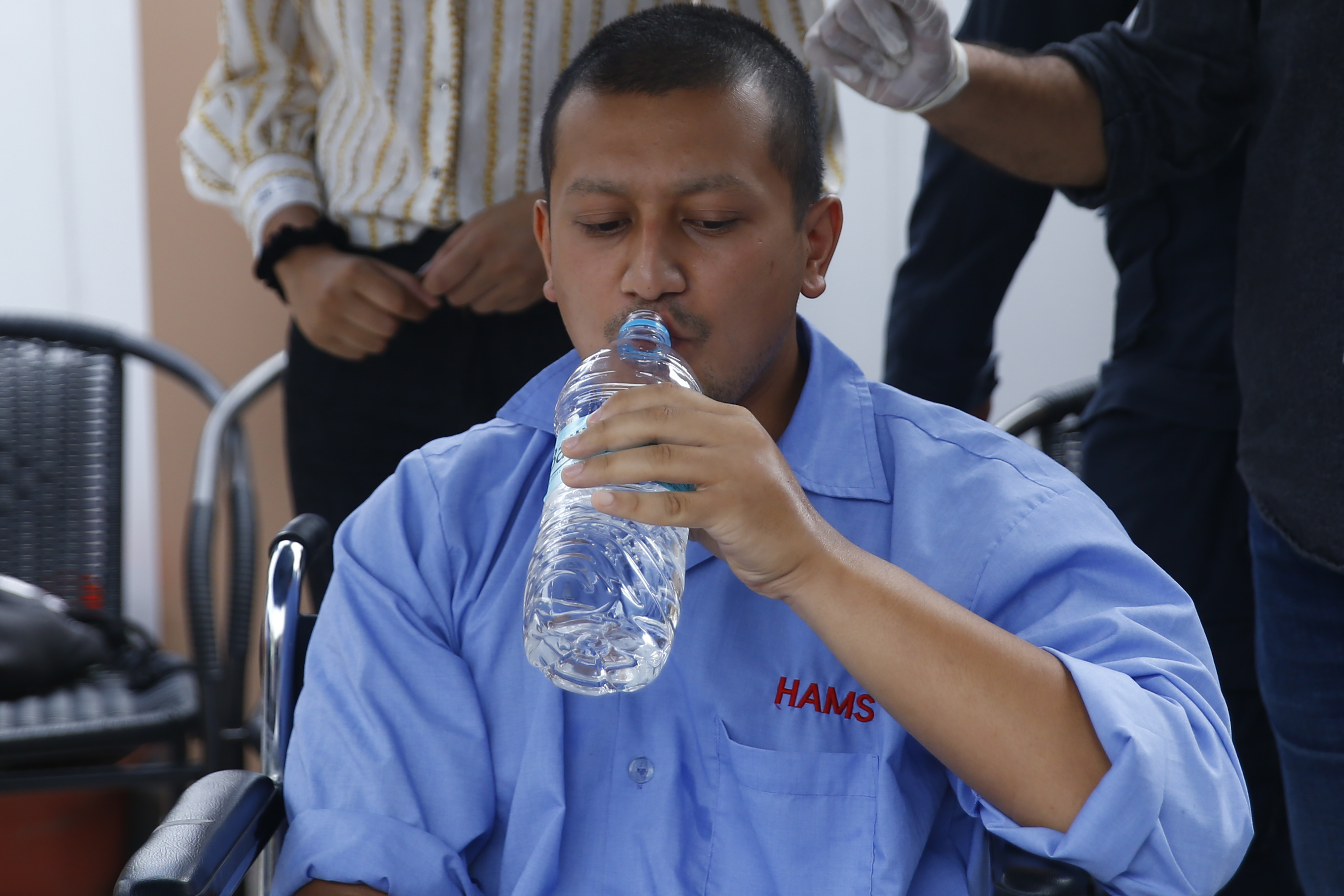 FILE - Seen in the picture, Iih drinks water, breaking his 12-day long fast unto death on Tuesday. Photo: Skanda Gautam/THT
