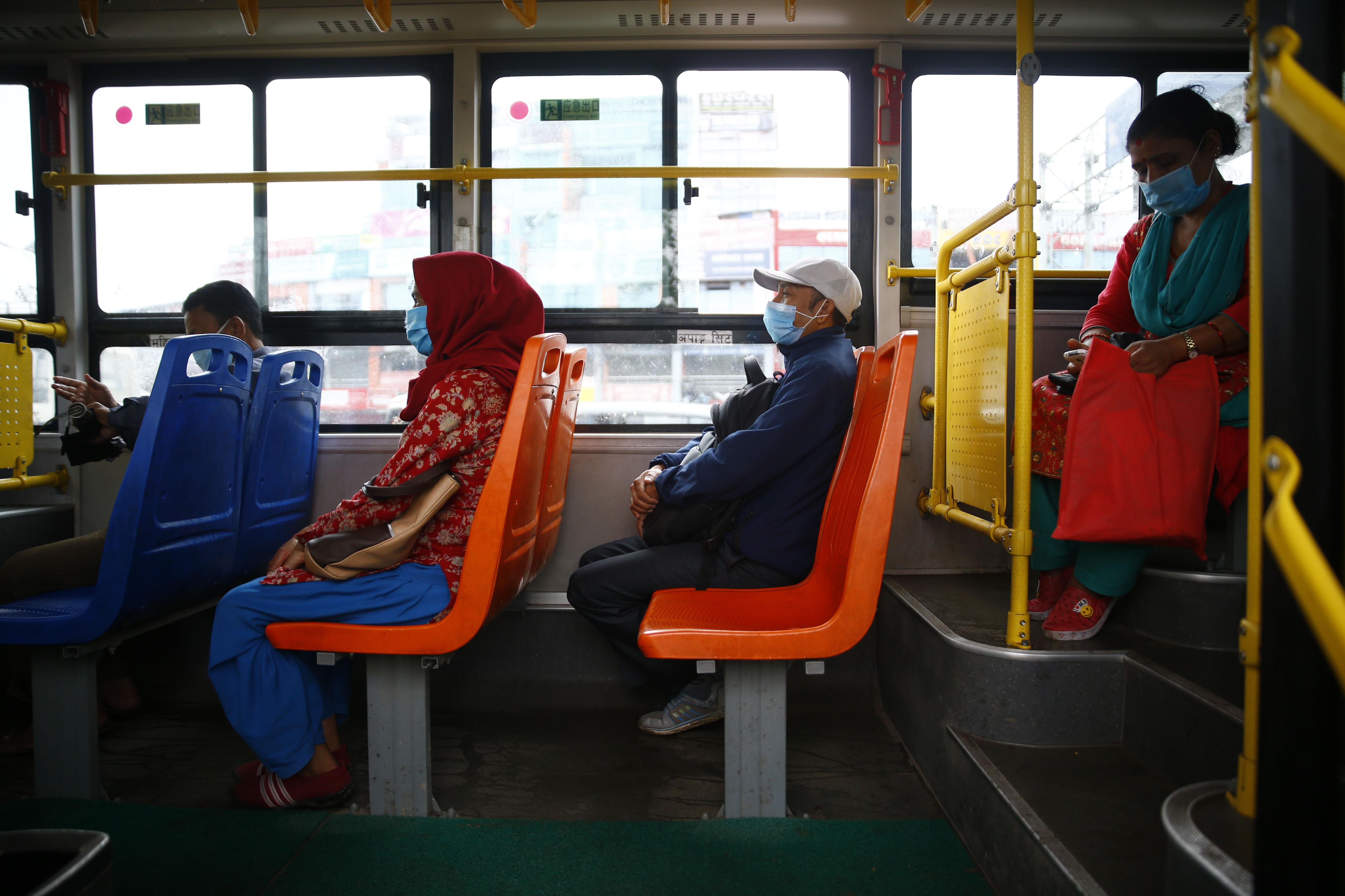 Passengers on board the recently launched Sundar Yatayat bus, as public transportation services gradually resume amid coronavirus pandemic, in Kathmandu, on Tuesday, July 14, 2020. Photo: Skanda Gautam/THT