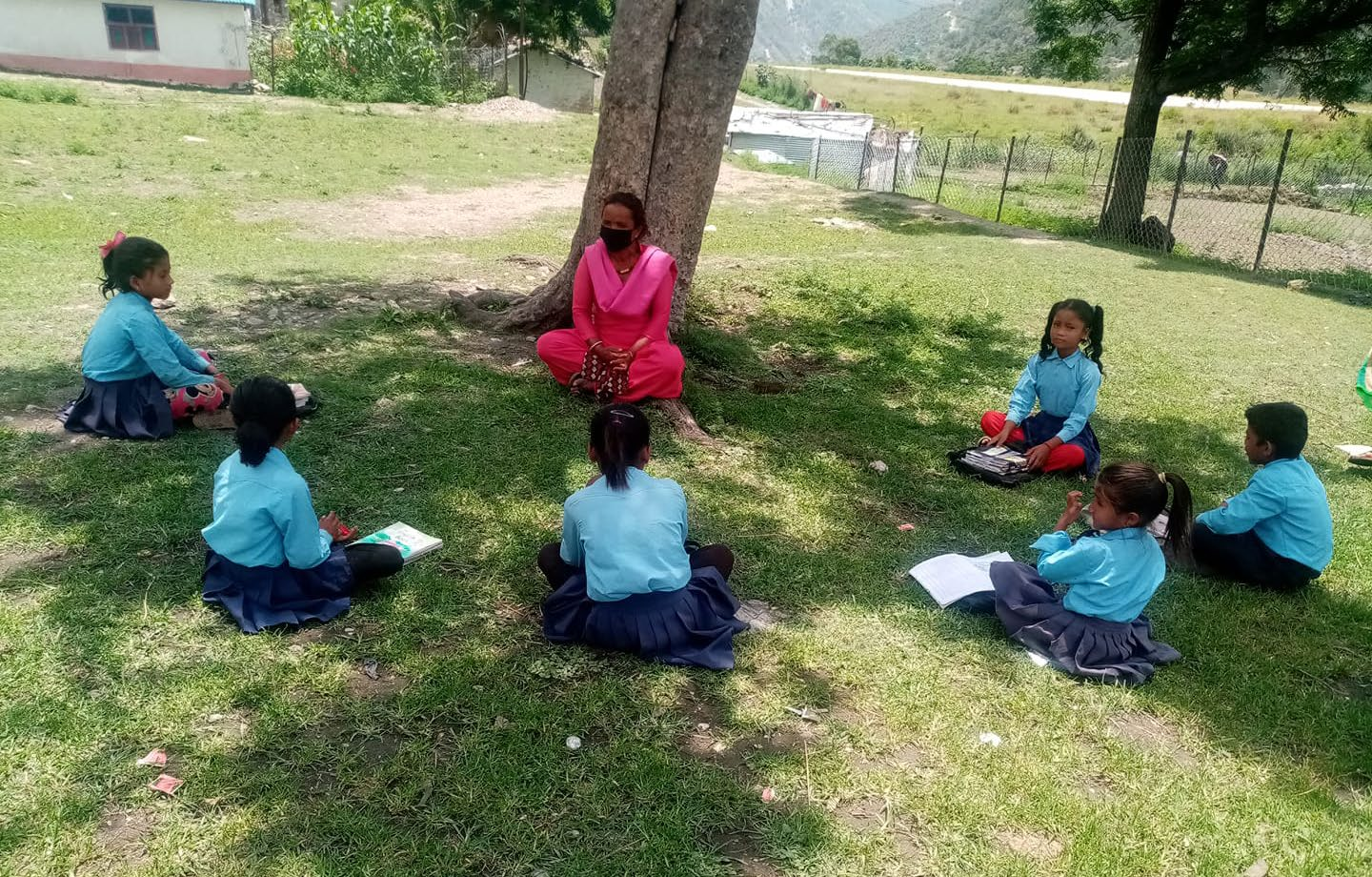 Students of Budhinanda Basic Level School attending a class in their tole in Kolti, Bajura, on Sunday. Photo: THT