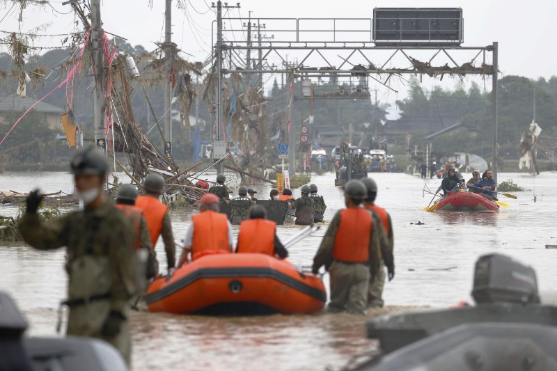 Local residents are rescued by Japanese Self-Defence Force soldiers using a boat at a flooding area caused by a heavy rain in Kuma village, Kumamoto prefecture, southern Japan, on July 5, 2020. Photo:  Kyodo/via Reuters