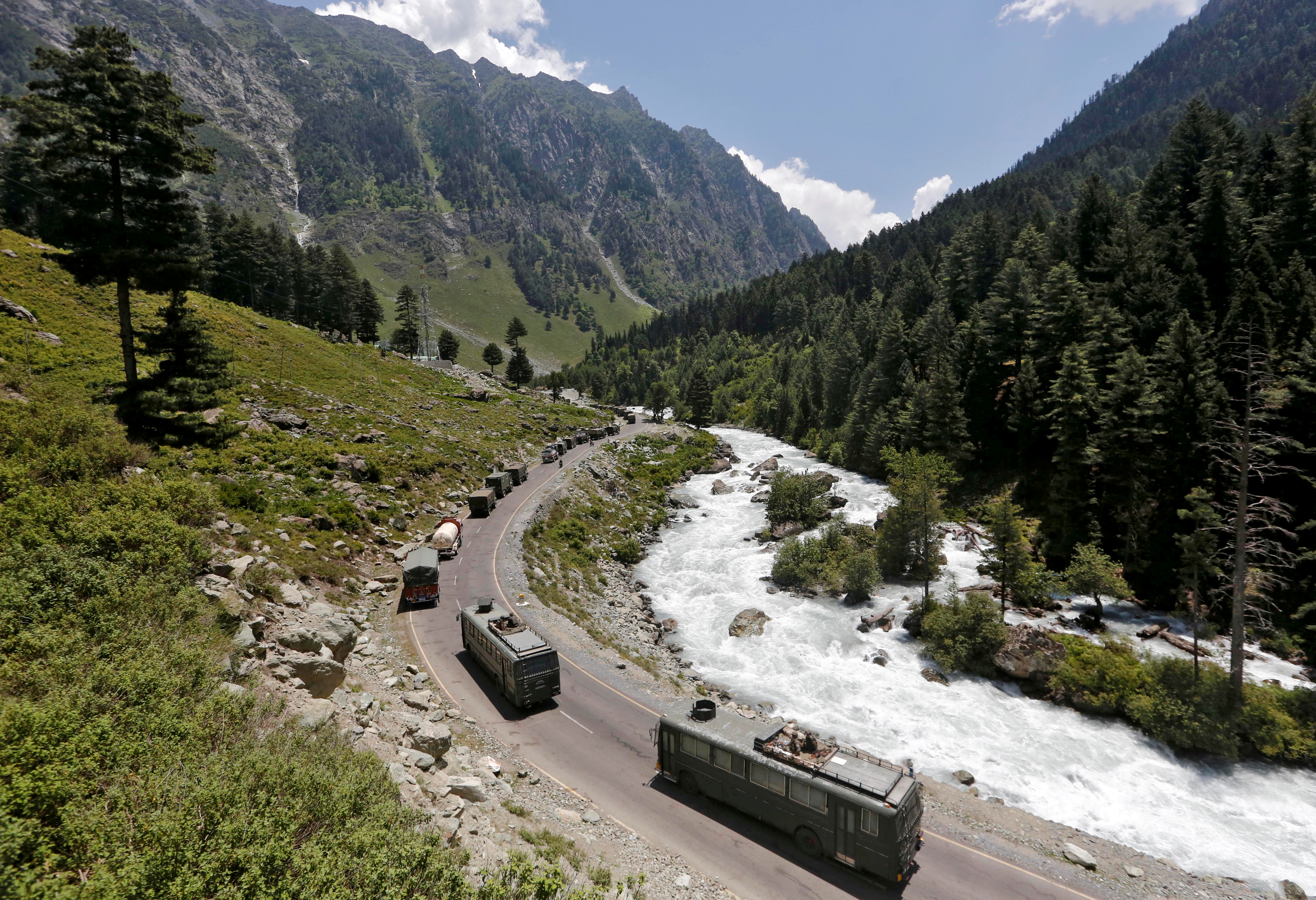 FILE PHOTO: An Indian Army convoy moves along a highway leading to Ladakh, at Gagangeer in Kashmir's Ganderbal district on June 18, 2020. Photo: Reuters