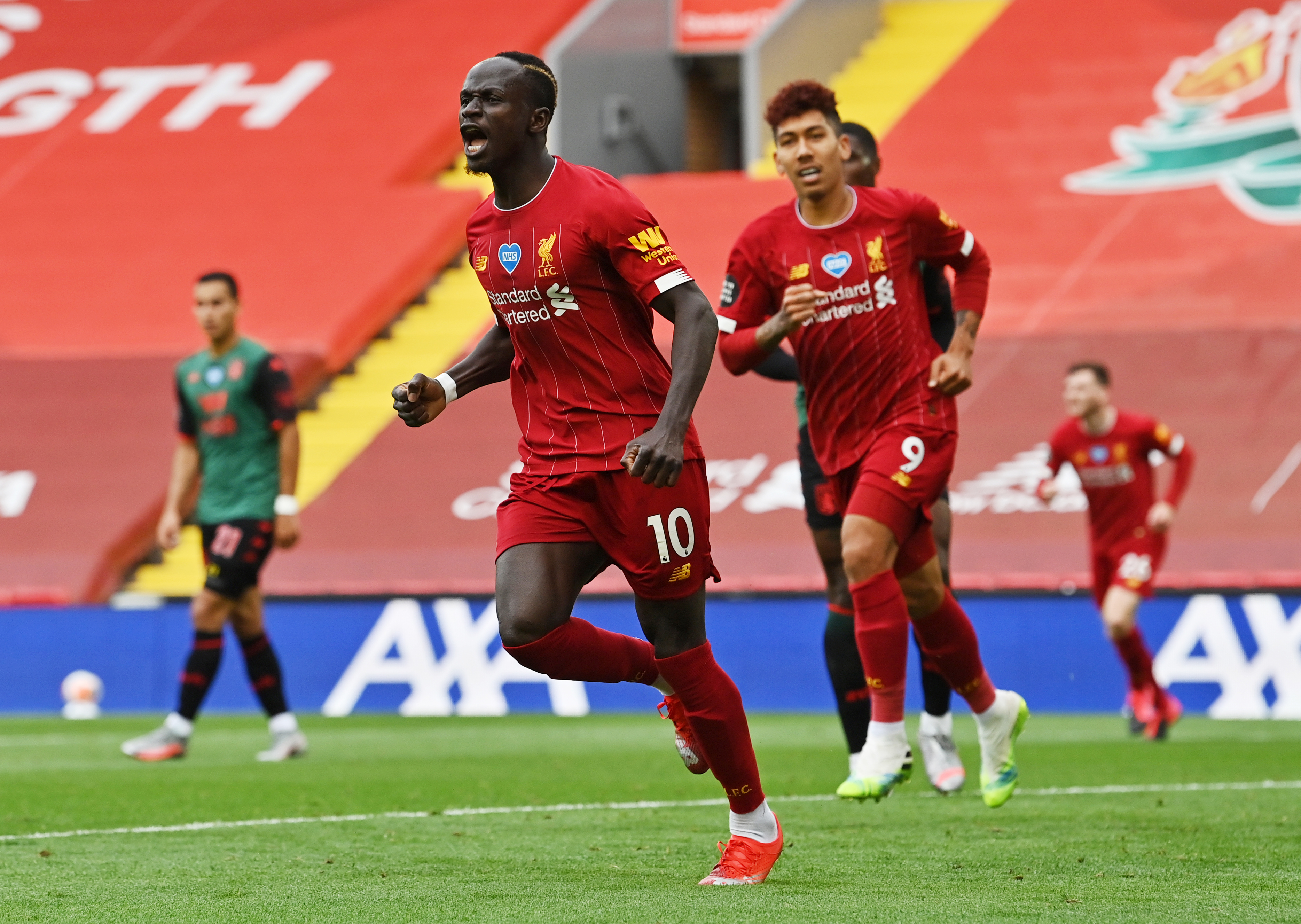 Liverpool's Sadio Mane celebrates scoring their first goal, as play resumes behind closed doors following the outbreak of the coronavirus disease (COVID-19). Photo: Reuters