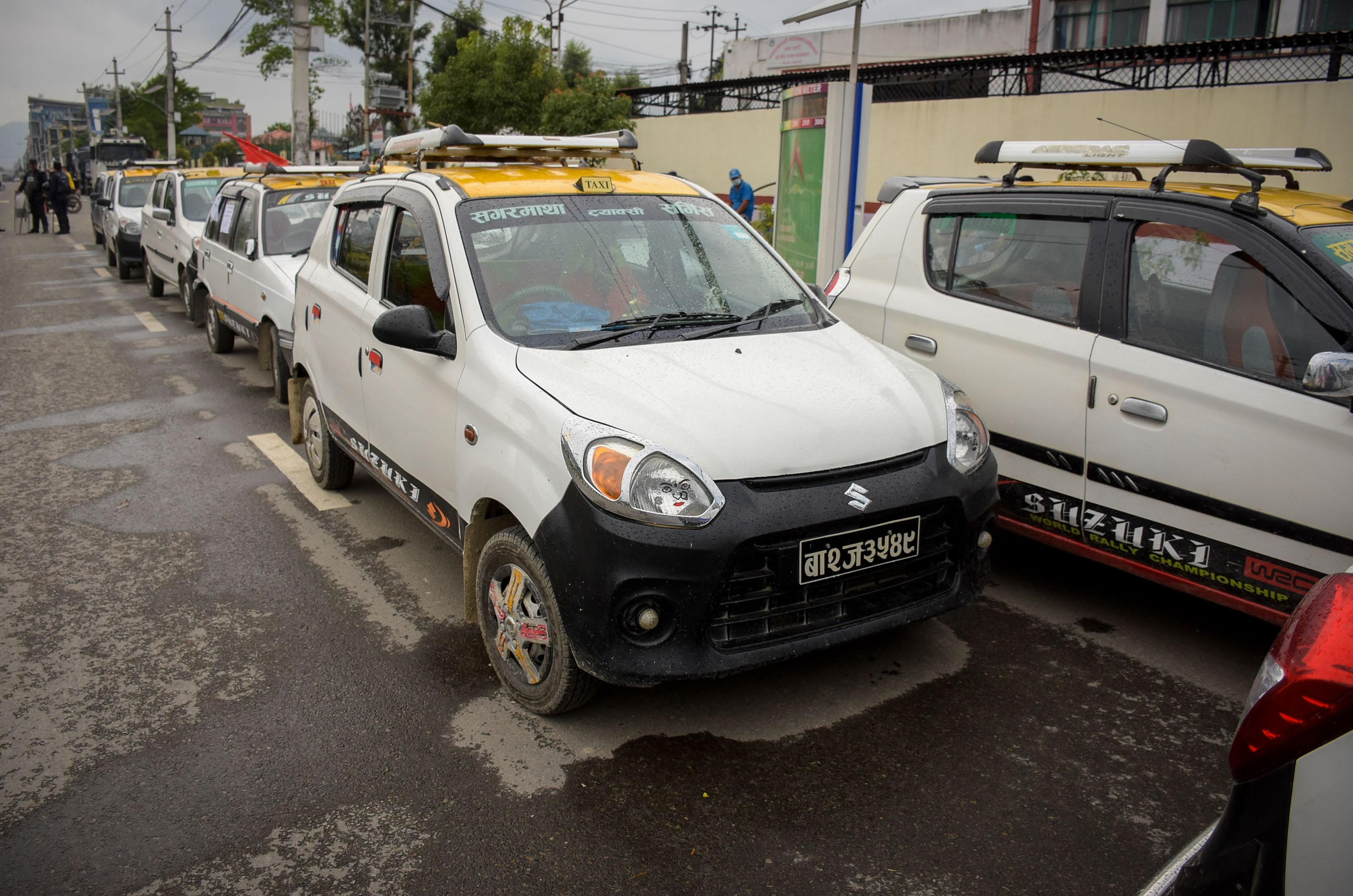 Taxis parked in a queue as part of a protest by cabbies, in Kathmandu, on Tuesday. They are demanding resumption of taxi service during the eased lockdown period. Photo: THT