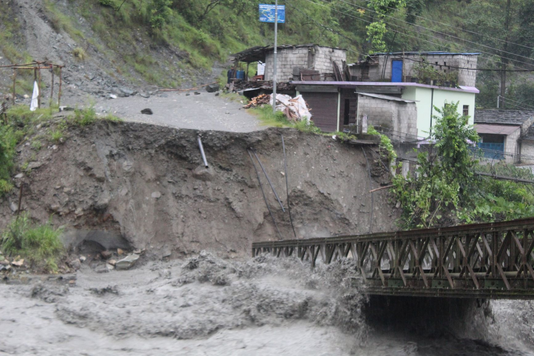 FILE - This image shows the destroyed motorable bridge over Raghuganga river, in Myagdi, as seen on Friday, July 10, 2020. Photo: Bharat Koirala/ THT