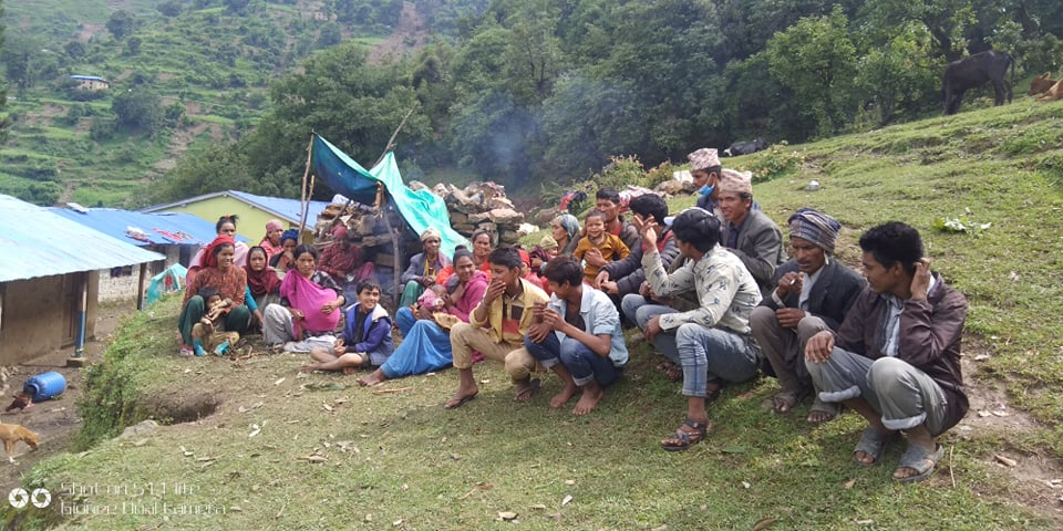 Locals affected by landslides and floods await relief, in Jajarkot, on Tuesday, July 21, 2020. Photo: Dinesh Kumar Shrestha/THT